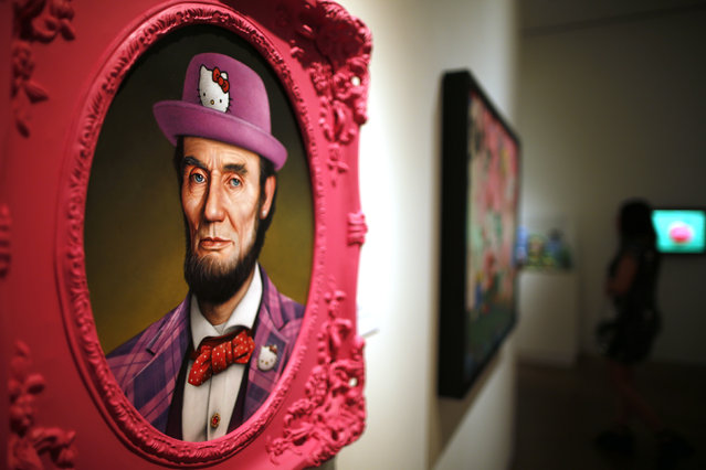 """A painting titled """"Hello Lincoln"""" by Scott Scheidly hangs at the """"Hello! Exploring the Supercute World of Hello Kitty"""" museum exhibit in honor of Hello Kitty's 40th anniversary, at the Japanese American National Museum in Los Angeles, California October 10, 2014. (Photo by Lucy Nicholson/Reuters)"""