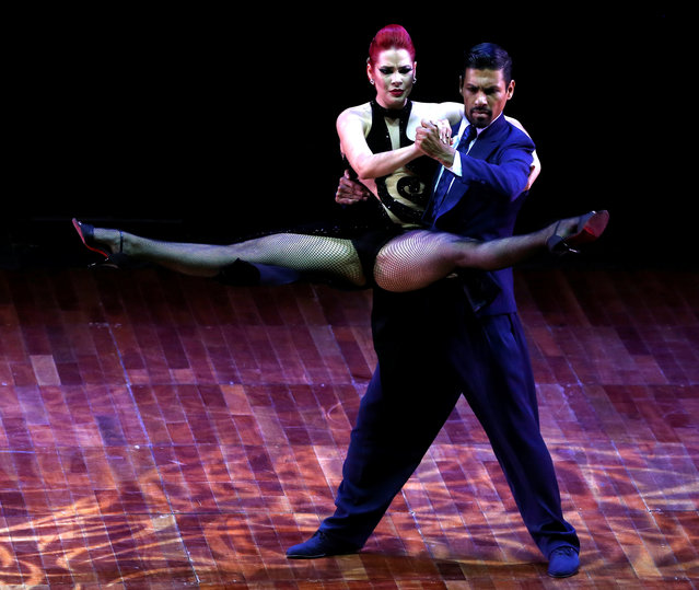 Andres Uran and Estefania Arango, from Colombia, perform their routine on their way to win the third place at the Stage style Tango World Championship, in Buenos Aires, Argentina, August 31, 2016. (Photo by Enrique Marcarian/Reuters)