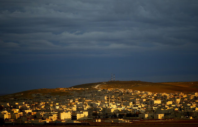 A general view of the Syrian town of Kobani is pictured from near the Mursitpinar border crossing, on the Turkish-Syrian border in the southeastern town of Suruc, October 19, 2014. (Photo by Kai Pfaffenbach/Reuters)