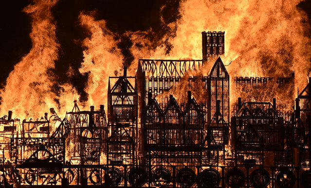 A 120-metre long model of London's sky line in the 17th Century is set alight on the River Thames in London as part of the London's Burning festival to mark the 350th anniversary of the Great Fire of London and its aftermath, on Sunday September 4, 2016. (Photo by Hannah McKay/PA Wire)
