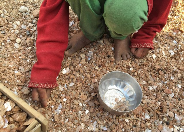 A five-year-old  girl collects mica flakes from an open cast illegal mica mine in Giridih district in the eastern state of Jharkhand, India, January 22, 2016. (Photo by Nita Bhalla/Reuters)