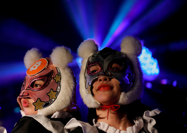 "Members of Japan's idol group ""Virtual Currency Girls"" wearing cryptocurrency-themed masks perform in their debut stage event in Tokyo, Japan, January 12, 2018. Each group member adopted the guise of a different cryptocurrency, offering a brief self-introduction to 20 fans gathered at the venue in downtown Tokyo. (Photo by Kim Kyung-Hoon/Reuters)"