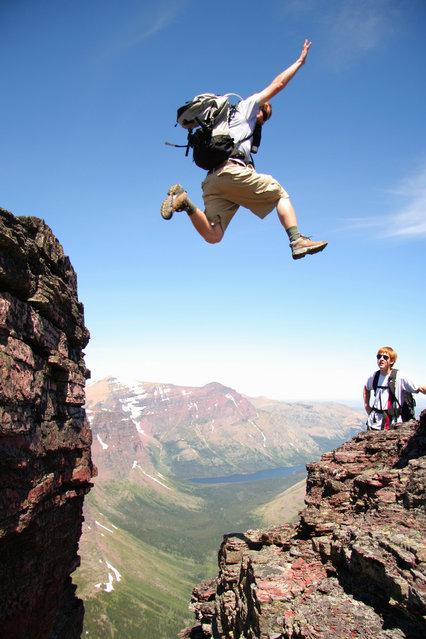 """Jumpology"". ""Just enough flight!"". Glacier National Park, MT.. (Photo by Elliot Jenko)"