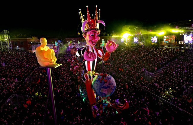 """The King of the Nice Carnival's float parades during the celebrations in Nice, France on February 16, 2013. The carnival celebrates the theme """"King of the 5 continents"""". (Photo by Lionel Cironneau/Associated Press)"""