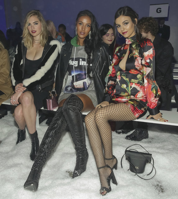 Kate Upton, from left, Maya Jama and Victoria Justice attend the Philipp Plein 2018 Fall/Winter Runway Show during New York Fashion Week at the Brooklyn Navy Yard on Saturday, February 10, 2018, in New York. (Photo by Brent N. Clarke/Invision/AP Photo)