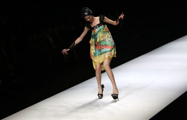 A model nearly falls as she presents a creation by Chinese designer Qi Gang during a fashion show at China Fashion Week for Spring/Summer 2012 in Beijing October 27, 2011. (Photo by Jason Lee/Reuters)