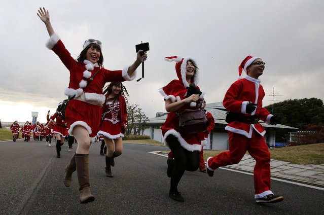 People dressed in Santa costumes participate in the Tokyo Santa Run at a park in Tokyo December 6, 2014. (Photo by Yuya Shino/Reuters)