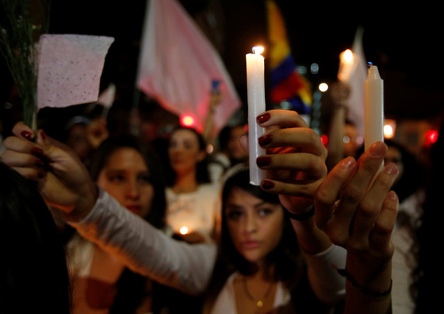 """Supporters of the peace deal signed between the government and the Revolutionary Armed Forces of Colombia (FARC) rebels gather at Bolivar Square during a """"Silent March"""" in Bogota, Colombia, October 5, 2016. (Photo by John Vizcaino/Reuters)"""
