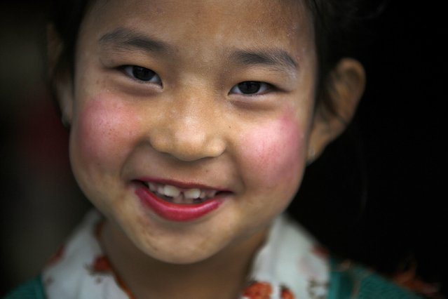A Tibetan girl in traditional attire takes part during a function organised by the Tibetan Refugee Community in Nepal, commemorating the 25th Anniversary of the Nobel Peace Prize conferment to exiled Tibetan spiritual leader Dalai Lama and the 66th International Human Rights Day in Kathmandu December 10, 2014. (Photo by Navesh Chitrakar/Reuters)