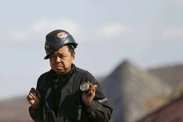 A miner walks out of a coal mine from the state-owned Longmay Group on the outskirts of Jixi, in Heilongjiang province, China, October 24, 2015. (Photo by Jason Lee/Reuters)