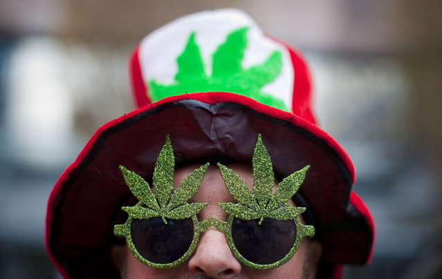 A man, wearing a marijuana-themed hat and sunglasses, is pictured at the Vancouver Art Gallery during the annual 4/20 day, which promotes the use of marijuana, in Vancouver, British Columbia April 20, 2013. (Photo by Ben Nelms/Reuters)