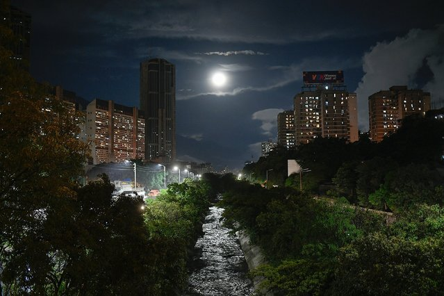 The El Guaire River is illuminated by a full moon in Caracas, Venezuela, Saturday, October 31, 2020, amid the new coronavirus pandemic lockdown. (Photo by Matias Delacroix/AP Photo)