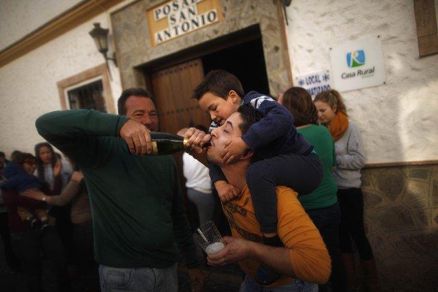 "Winners of Spain's Christmas Lottery ""El Gordo"" celebrate in El Gastor, near Cadiz, December 22, 2014. (Photo by Jon Nazca/Reuters)"