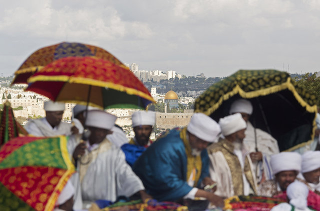 Ethiopian Jew pray during the 'Sigd' holiday in Jerusalem, Wednesday, November 11, 2015. The prayer is performed by Ethiopian Jews every year to celebrate the biblical union between the Jewish people and God. (Photo by Ariel Schalit/AP Photo)