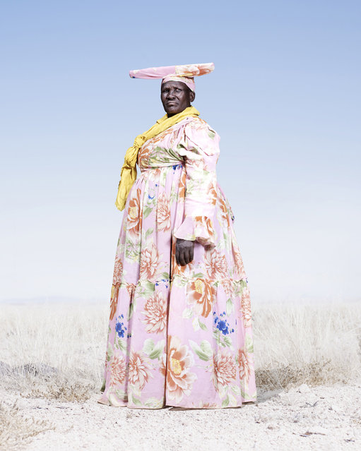 Herero Woman in Pink and Pattern Dress, 2012. (Photo by Jim Naughten, courtesy of Klompching Gallery, New York)