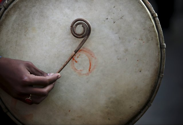 A hand of a Newari boy using a bamboo stick plays a traditional musical instrument during the Tihar festival, also called Diwali, in Kathmandu, Nepal November 12, 2015. (Photo by Navesh Chitrakar/Reuters)