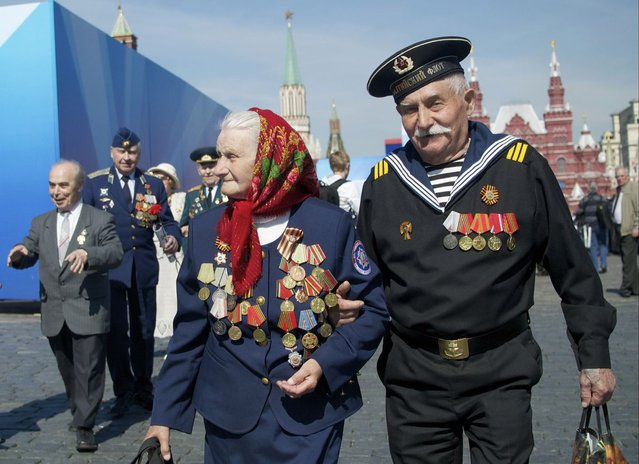 Russian WWII veterans walk after a Victory Day parade at Red Square on Thursday, May 9, 2013. President Vladimir Putin said at the annual military parade hat Russia will be a guarantor of world security. Putin's short speech came at the culmination of Victory Day, marking the defeat of Nazi Germany 68 years ago. It is Russia's most important secular holiday, honoring the huge military and civilian losses of World War II and showing off the country's modern arsenal. (Photo by Ivan Sekretarev/AP Photo)