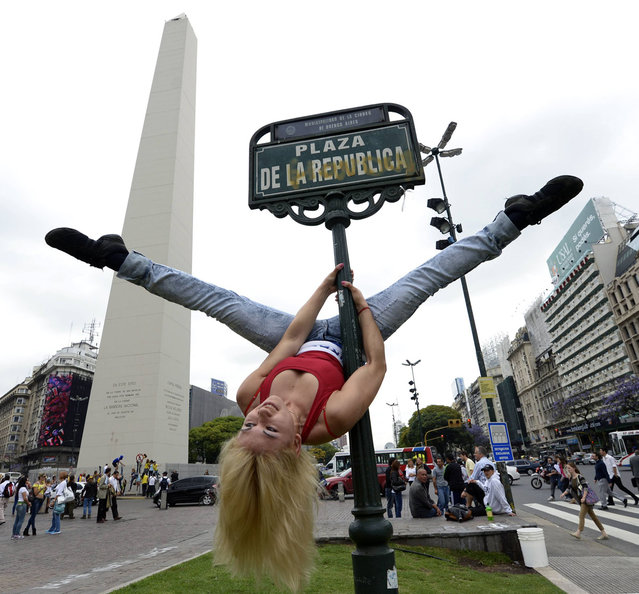 A Paraguayan participant in the Pole Dance South America 2012 competition performs at Republica square in downtown Buenos Aires on November 23, 2012 ahead of the contest to be held on November 24 and 26 in Buenos Aires. (Photo by Juan Mabromata/AFP Photo)