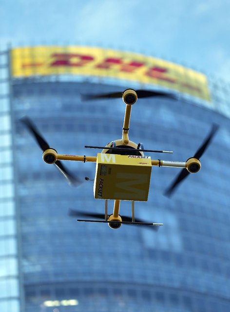 In this December 9, 2013 file photo, a Deutsche Post DHL drone carrying a small parcel is demonstrated for journalists in Bonn, Germany. (Photo by Oliver Berg/AP Photo/DPA)