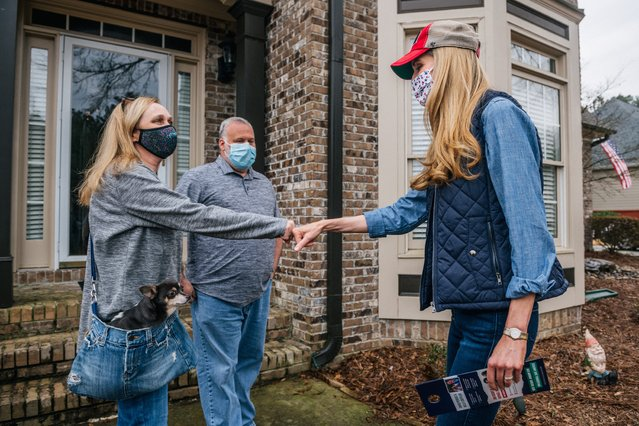 Senator Kelly Loeffler (R), greets neighborhood residents during a canvassing event on January 2, 2021 in Loganville, Georgia. In the lead-up to the January 5 runoff election, Georgia Republican Senator Kelly Loeffler continues to focus on early voting efforts across the state of Georgia. (Photo by Brandon Bell/Getty Images)