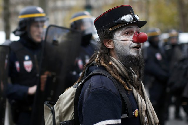 An environmentalist attends a demonstration near French CRS police before clashes at the Place de la Republique after the cancellation of a planned climate march following shootings in the French capital, ahead of the World Climate Change Conference 2015 (COP21), in Paris, France, November 29, 2015. (Photo by Benoit Tessier/Reuters)