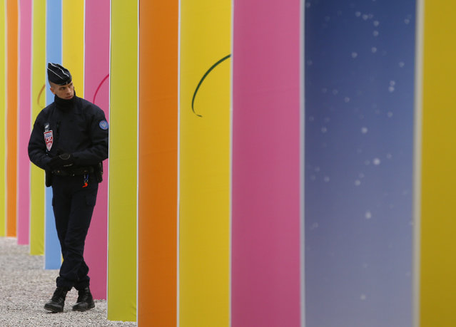 A riot police officer patrols at the COP21, the United Nations Climate Change Conference Tuesday, December 1, 2015 in Le Bourget, north of Paris. (Photo by Christophe Ena/AP Photo)