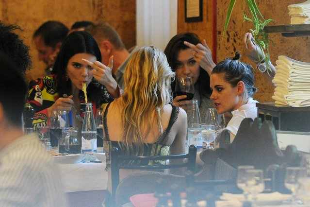 Model friends Bella Hadid, Kendall Jenner, Stella Maxwell and actress Kristen Stewart and are seen having dinner together in Milan, Italy on June 16, 2018. Bella and Kendall cheekily showed the camera middle finger while couple Stella and Kristen talked. (Photo by Splash News and Pictures)