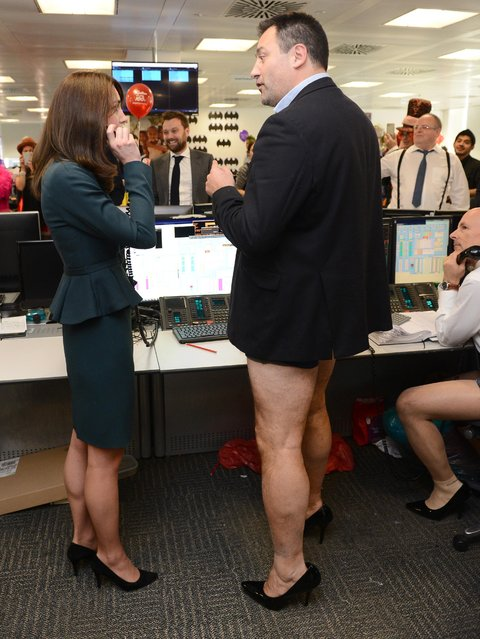 Kate Duchess of Cambridge meets trader Nigel Hagen, wearing high heel shoes as she attends ICAP's 23rd annual Charity Day in London Wednesday December 9, 2015.  (Photo by Jeremy Selwyn, Pool via AP Photo)