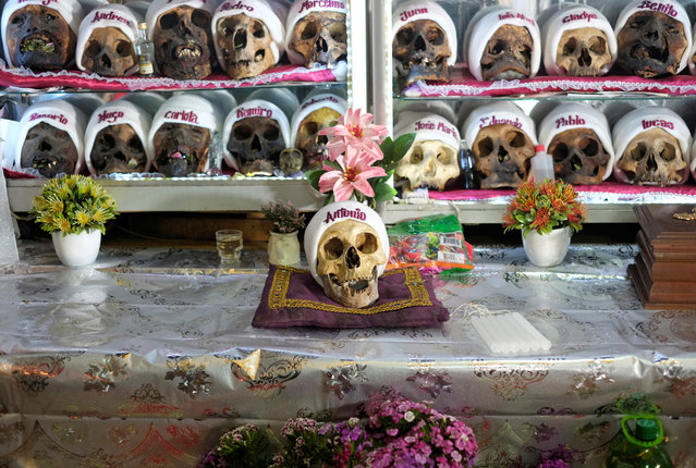 Natitas, skulls of the dead, who people asking for blessings, health and protection are seen before the Dia de las Natitas (Day of the Skulls) celebrations, in La Paz, Bolivia on November 7, 2020. (Photo by David Mercado/Reuters)