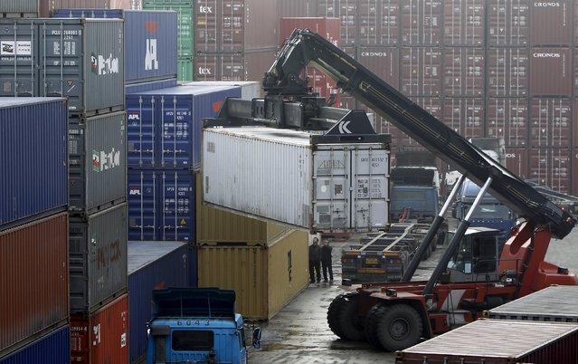 Workers load trucks with containers at a terminal of an ICD (Inland Container Depot) in Uiwang, south of Seoul, in this February 1, 2010 file photo.  South Korea is expected to release trade figures this week. (Photo by Lee Jae-Won/Reuters)