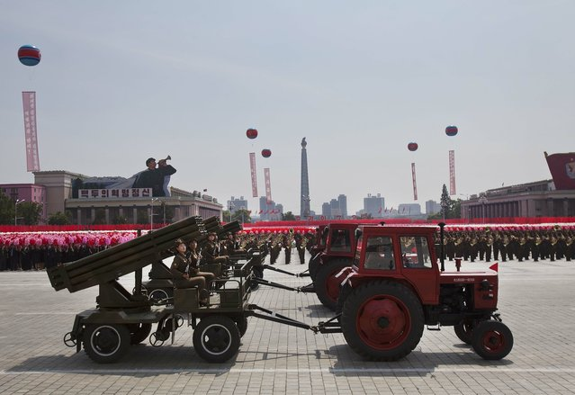 Tractors pull weapons on wagons at a mass military parade on Kim Il Sung Square in Pyongyang to mark the 60th anniversary of the Korean War armistice Saturday, July 27, 2013. (Photo by David Guttenfelder/AP Photo)
