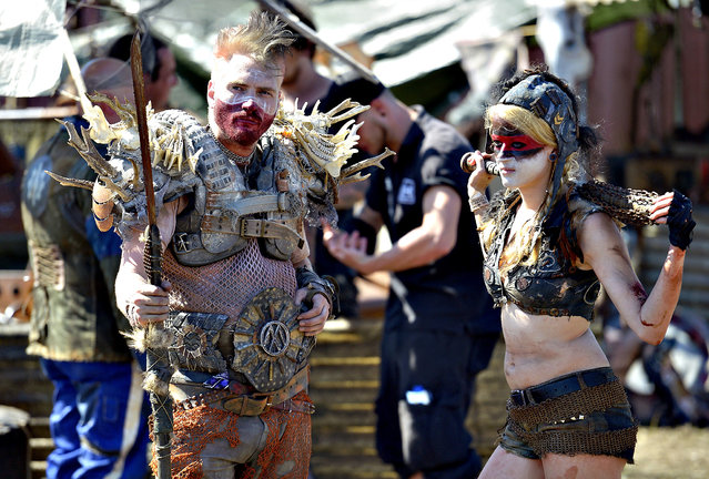 Visitors from a group of end time role gamers enjoy the Wacken Open Air heavy metal music fest on August 2, 2013 in Wacken, Germany. Approximately 75,000 heavy metal fans from all over the world descend every year on the north German village of 1,800 residents for the annual three-day fest. (Photo by Patrick Lux/Getty Images)