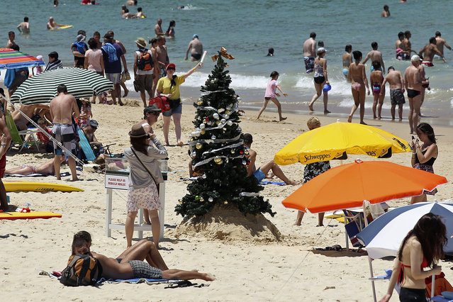 A Christmas tree stands on Bondi Beach in Sydney, Australia, Sunday, December 25, 2011. (Photo by Rob Griffith/AP Photo)