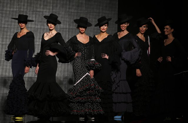 Models present creation by Rocio Peralta during the International Flamenco Fashion Show SIMOF in the Andalusian capital of Seville February 5, 2015. (Photo by Marcelo del Pozo/Reuters)