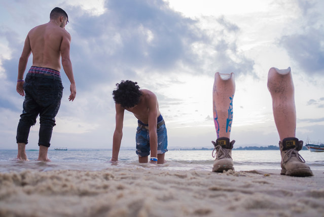 Known by his dance name of Zulu Rema, 16-year-old Guesmi practices on the shores of the Mediterranean with a fellow breakdancer. (Photo by Yassine Alaoui Ismaili/The Guardian)