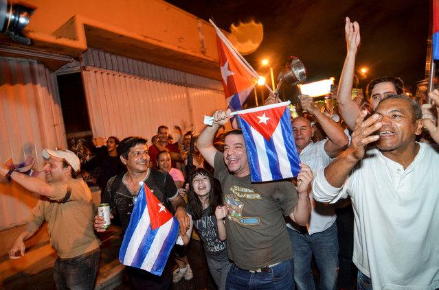 People celebrate the death of Cuban leader Fidel Castro, in Little Havana, Miami, Florida, U.S. November 26, 2016. (Photo by Gaston De Cardenas/Reuters)
