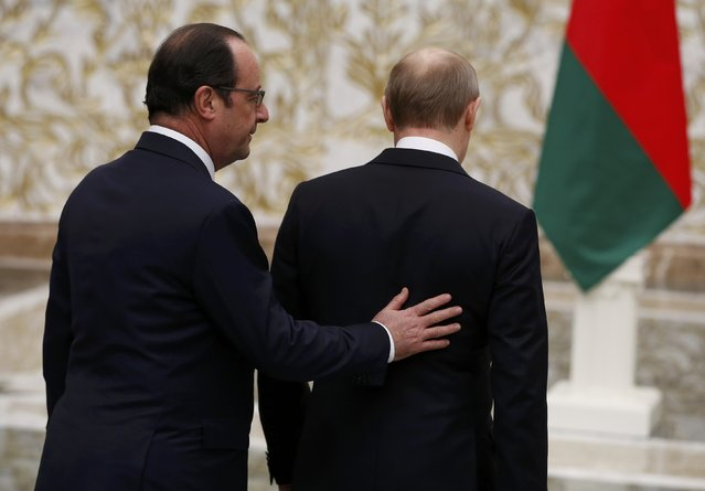 French President Francois Hollande and Russian President Vladimir Putin (R) walk after a meeting in Minsk, February 11, 2015. (Photo by Grigory Dukor/Reuters)
