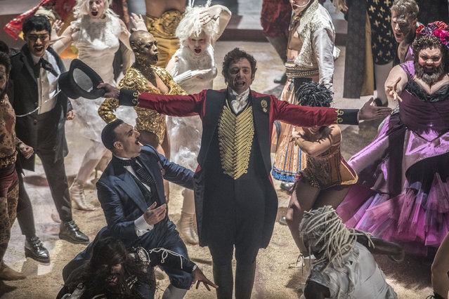 "This image released by Twentieth Century Fox shows Hugh Jackman in a scene from ""The Greatest Showman"". On Monday, December 11, 2017, Jackman was nominated for a Golden Globe for best actor in a motion picture comedy or musical for his role in the film. The 75th Golden Globe Awards will be held on Sunday, Jan. 7, 2018 on NBC. (Photo by Niko Tavernise/Twentieth Century Fox via AP Photo)"