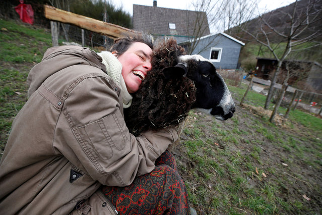 Lexa Voss, personality development coach, cuddles sheep Karlotta at her little farm, where she holds sheep cuddling seminars during COVID-19 lockdown in Hattingen, near Wuppertal, Germany, March 11, 2021. (Photo by Wolfgang Rattay/Reuters)