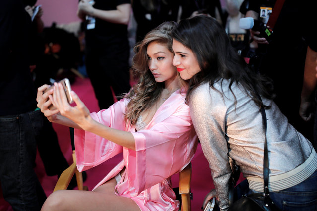 Model Gigi Hadid makes a selfie as she gets ready backstage before the Victoria's Secret Fashion Show at the Grand Palais in Paris, France, November 30, 2016. (Photo by Benoit Tessier/Reuters)