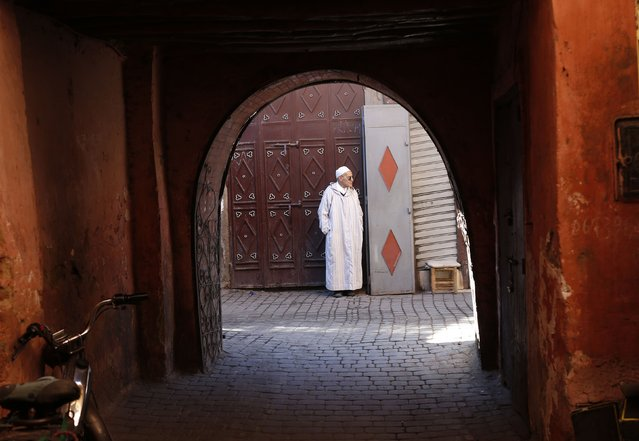 A man stands along in a medina street of the city of Marrakech December 10, 2014. (Photo by Youssef Boudlal/Reuters)