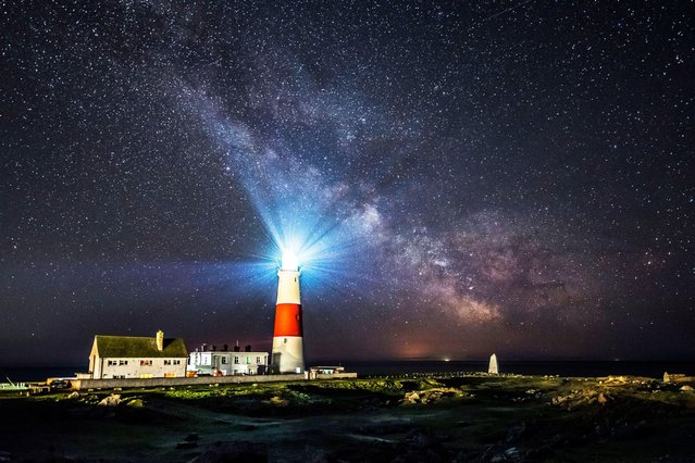 The galactic centre of the Milky Way glows brightly in the clear night sky above the lighthouse at Portland Bill on the Dorset Jurassic Coast, United Kingdom on April 13, 2021. (Photo by Graham Hunt/Alamy Live News)