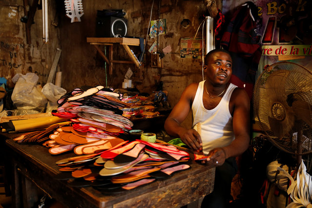 A man works on footwear in Araria market in Aba, Nigeria August 19, 2016. (Photo by Afolabi Sotunde/Reuters)