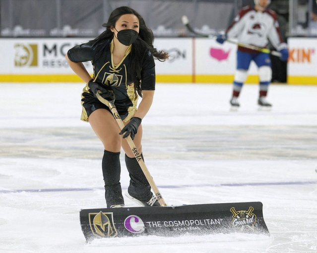 A member of the Knights Guard cleans the ice during the Vegas Golden Knights' game against the Colorado Avalanche at T-Mobile Arena on April 28, 2021 in Las Vegas, Nevada. The Golden Knights defeated the Avalanche 5-2. (Photo by Ethan Miller/Getty Images via AFP Photo)