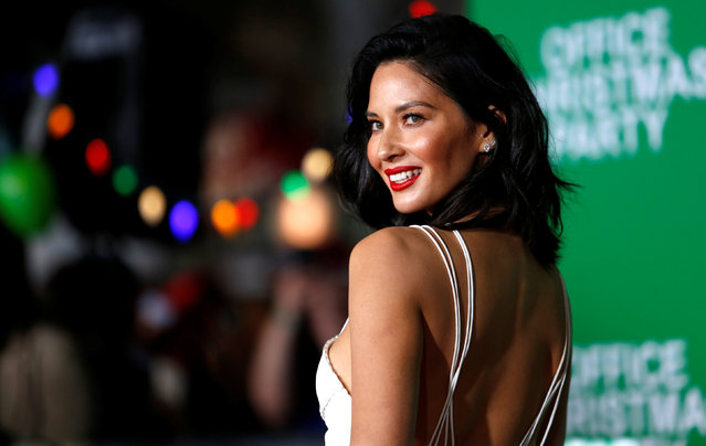 """Cast member Olivia Munn poses at the premiere of """"Office Christmas Party"""" in Los Angeles, California, U.S. December 7, 2016. (Photo by Mario Anzuoni/Reuters)"""