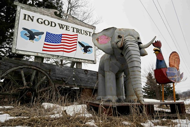 Metal sculptures of animals are placed in front of a sign in Jewell, Iowa, United States, January 16, 2016. (Photo by Jim Young/Reuters)