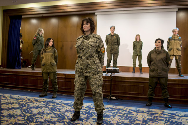 Female soldiers of the self-proclaimed Donetsk People's Republic pose on stage during a beauty pageant to mark International Women's Day in Donetsk, March 7, 2015. (Photo by Marko Djurica/Reuters)