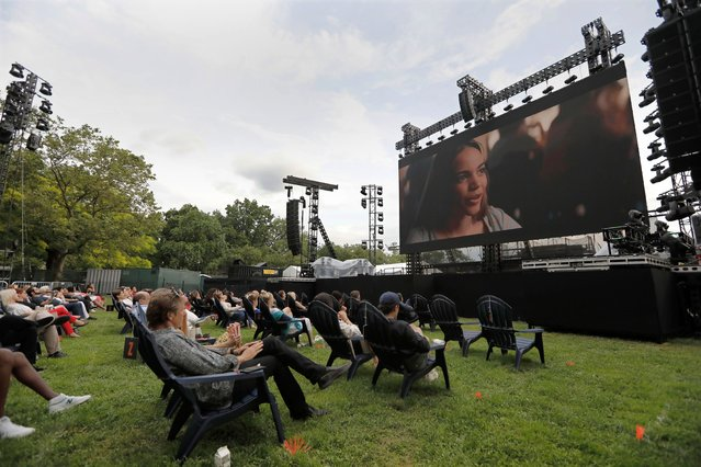 """Moviegoers watch the film """"In The Heights"""" during the Opening Night of the 2021 Tribeca Film Festival at The Battery, in New York, New York, USA, 09 June 2021. (Photo by Peter Foley/EPA/EFE)"""