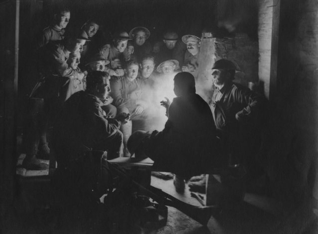 British soldiers sitting around a lamp in their trench, circa 1916. (Photo by Hulton Archive/Getty Images)