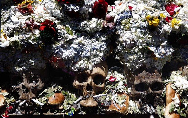 Decorated skulls on display at the Cementerio General. (Photo by Juan Karita/Associated Press)